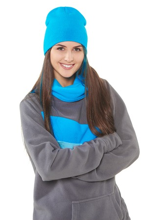 white hat: Young woman in winter sport clothing standing isolated on white background Stock Photo