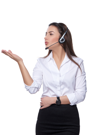 imaginary dialogue: Support phone operator in headset blowing at her palm with empty copy space, isolated on white