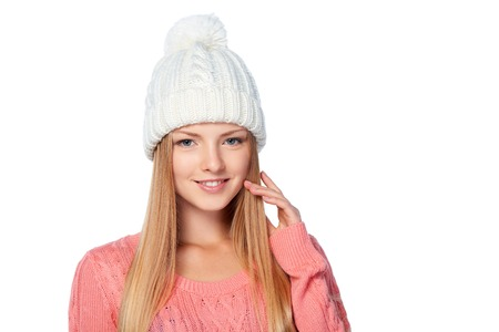 cold background: Closeup portrait of woman on white background wearing warm winter clothing