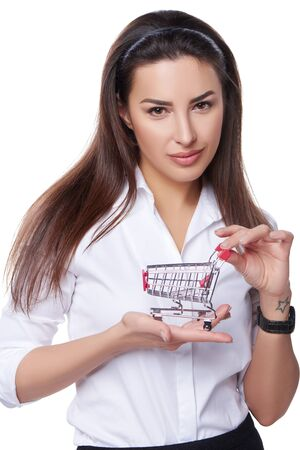 woman white shirt: Shopping concept. Confident woman holding small empty shopping cart on her palm