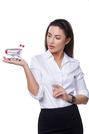 woman shopping cart: Shopping concept. Confident woman holding small empty shopping cart on her palm