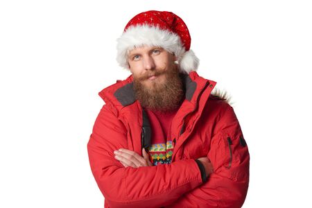 Bearded man in red winter jacket and christmas hat, over white Stock Photo
