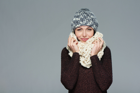 one woman: Christmas girl, winter concept. Young beautiful smiling girl over grey background Stock Photo