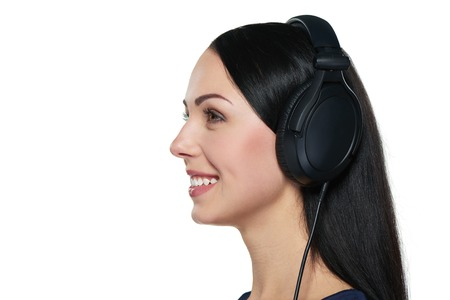 closeup view: Closeup side view of a girl listening to music, over white background
