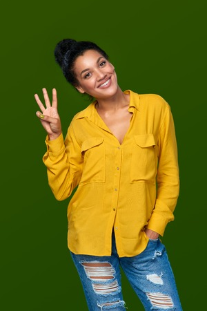 three fingers: Hand counting - three fingers. Happy mixed race african american - caucasian woman showing three fingers