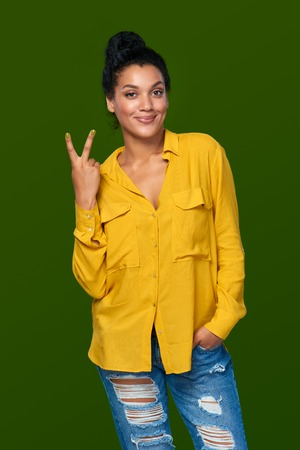victory sign: Success concept. Happy mixed race african american - caucasian woman showing Victory sign