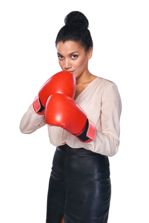 business competition: Strength, power or competition concept. Businesswoman wearing boxing gloves ready to fight, isolated on white background.