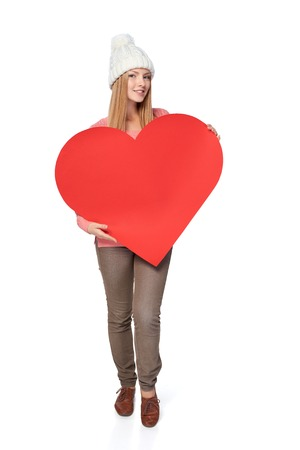 full length woman: Full length woman holding big heart shaped banner with copy space. Valentines Day Stock Photo