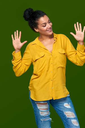 number ten: Hand counting - ten fingers. Happy mixed race african american - caucasian woman indicating the number ten with her fingers