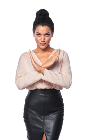 restrain: Serious mixed race caucasian - african american business woman showing stop hand sign, over white background Stock Photo