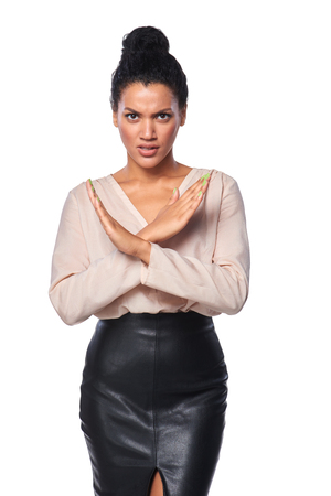 executive woman: Angry mixed race caucasian - african american business woman showing stop hand sign, over white background