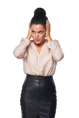hands over ears: Displeased business woman with hands on ears, over white background Stock Photo