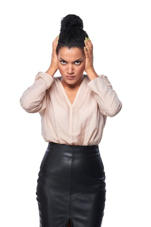 woman standing: Displeased business woman with hands on ears, over white background Stock Photo