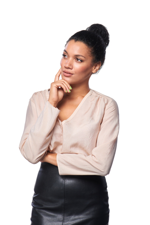 away: Confident successful mixed race caucasian - african american business woman thinking and looking away at blank copy space