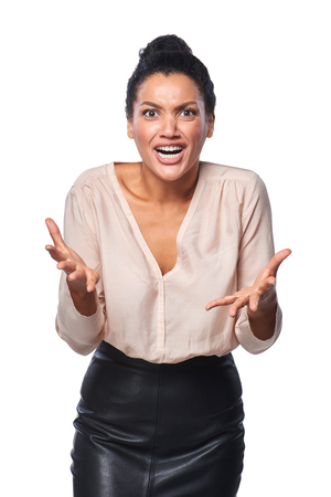 scream: Business woman shrugging her shoulders and screaming in anger and frustration, isolated on white background