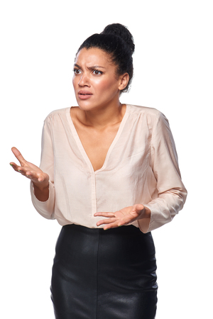 Business woman shrugging her shoulders in anger and frustration, isolated on white background Stock Photo