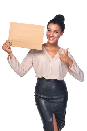 approving: Smiling businesswoman with parcel over white background, showing approving gesture Stock Photo