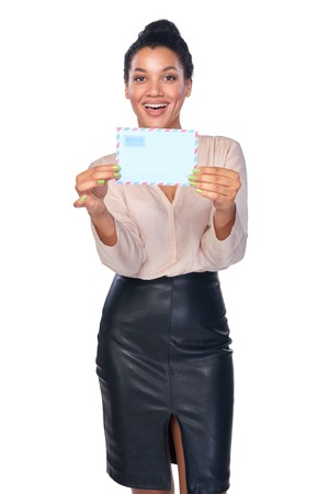happy african: Smiling businesswoman with envelope over white background Stock Photo