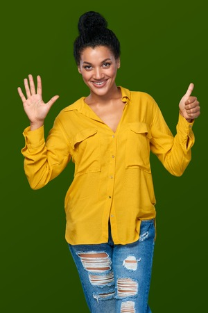 Hand counting - six fingers. Happy mixed race african american - caucasian woman indicating the number six with her fingers