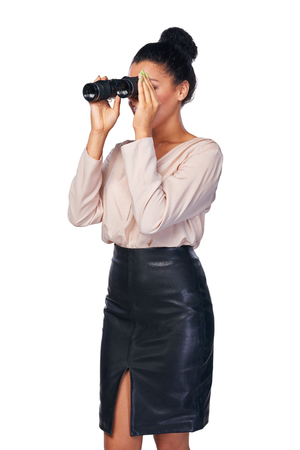 looking through: Business search concept. Smiling happy business woman looking through binoculars at blank copy space, isolated over white