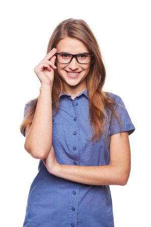 Portrait of confident successful business woman smiling holding her glasses at the rim Archivio Fotografico