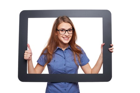 looking through frame: Happy smiling woman looking through frame and showing approving gesture, over white background