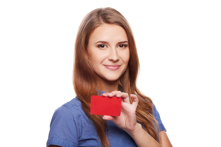 outstretching: Closeup of smiling business woman showing blank credit card, over white background Stock Photo