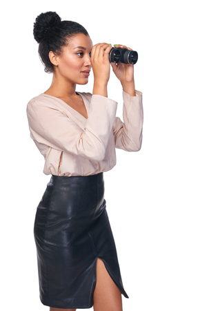 looking through: Business search concept. Side view of smiling happy business woman looking through binoculars at blank copy space, isolated over white