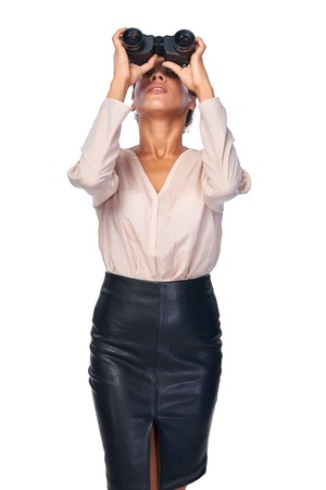looking through: Business search concept. Business woman looking through binoculars upwards, isolated over white Stock Photo