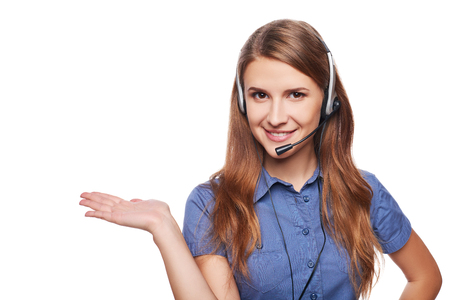 presenting: Support phone operator in headset smiling looking at camera and showing open hand palm with copy space for product or text, isolated on white