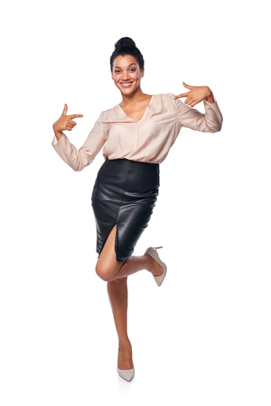 egocentric: Smiling content business woman in full length pointing at herself, isolated on white background