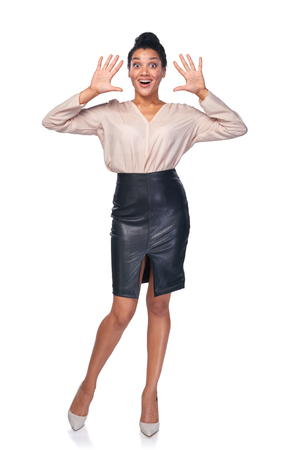number ten: Full length of happy excited business woman indicating the number ten with her fingers Stock Photo