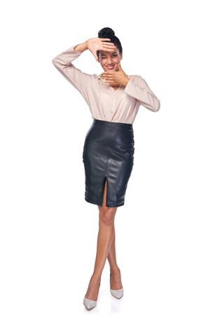 Full length business woman making frame with hands,isolated on white background