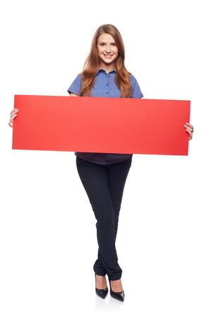 white poster: Full length young woman holding red blank cardboard, over white background