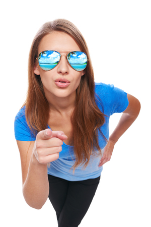 woman pointing: Holidays, travel, vacation concept. Woman in sunglasses with tropical resort beach reflection pointing her finger at camera and asking you Stock Photo
