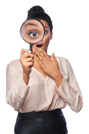 woman surprise: Funny image of young surprised female looking at the camera through a magnifying glass, isolated on white background
