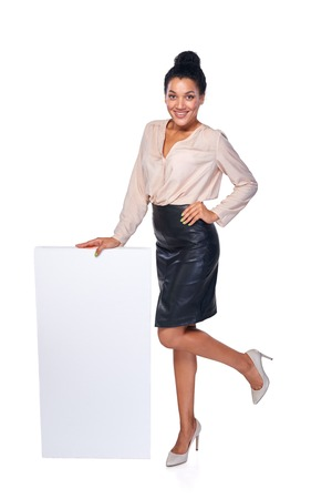 white playful: Happy playful woman standing leaning at blank white banner in full length, over white background