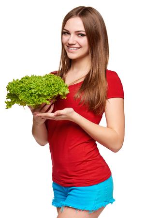 légumes verts: Heureuse femme avec de la laitue sur fond blanc