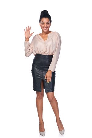 five: Hand counting - five fingers. Full length smiling mixed race african american - caucasian woman showing five fingers Stock Photo