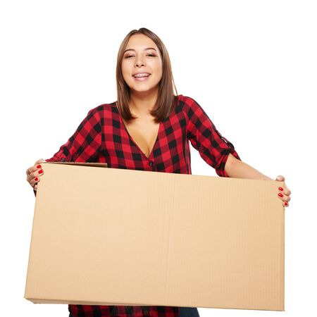single dwelling: Happy laughing young woman carrying cardboard box isolated on white background