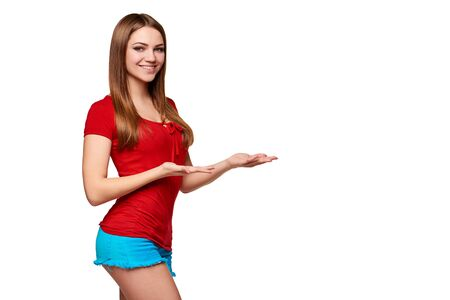 welcoming: Portrait of bright smiling teen girl showing open hand palm with copy space for product or text, over white background