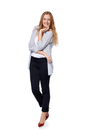 laugher: Fashion woman in full length happy smiling laughing over white background
