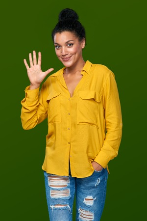 counting five: Hand counting - five fingers. Happy mixed race african american - caucasian woman showing five fingers