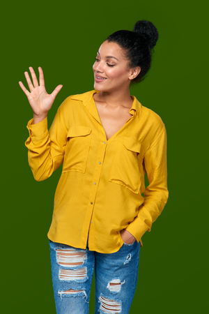 five fingers: Hand counting - five fingers. Happy mixed race african american - caucasian woman showing five fingers