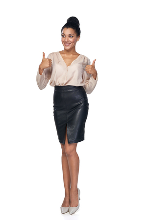 american content: Happy successful mixed race caucasian - african american business woman giving double thumb up and looking away at blank copy space, isolated on white background