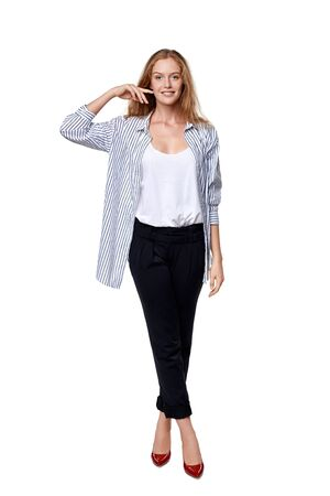 laugher: Fashion woman in full length happy smiling posing over white background
