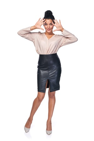 number ten: Full length of smiling business woman showing her palms, hand counting - number ten Stock Photo