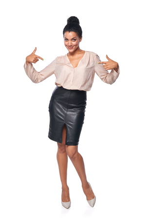 herself: Confident business woman in full length pointing at herself, isolated on white background