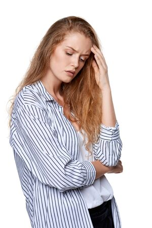 in thought: Portrait of beautiful sad woman, over white background