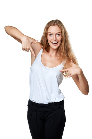 egocentric: Happy excited woman pointing at herself over white Stock Photo